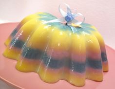 Commissioned by my friend Jill for her friend Ellen's baby shower I created this cute little pastel jello. The traditional baby color bands are comprised of lemon, blueberry, and strawberry gelatin...
