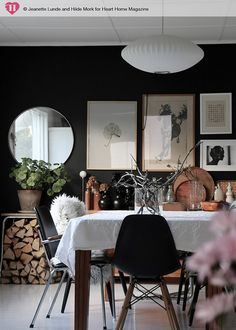 Dark walls with frames and mirror