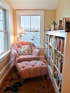 This tiny cozy reading nook has a convenient wall of bookshelves within easy reach.