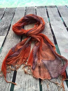 Rolling waves in soft purple, under a sun of jade green, set on a backdrop of sunset orange for a sunburnt land.  Such a vibrant summer scarf in a rich blend of colours.