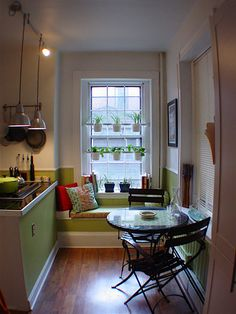 Small and cozy kitchen and dining table with a reading couch