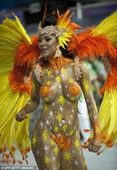 Samba time! Brazil's Carnival erupts in an explosion of colour as millions thunder through the streets for the start of the five-day fiesta