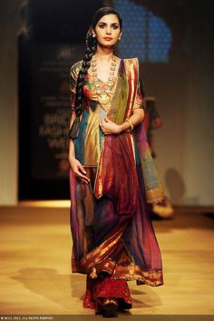 A model displays a creation by designers Ashima and Leena on Day 4 of India Bridal Fashion Week in New Delhi on July 25, 2013