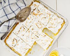 lemon coconut meringue bars; a coconut flaked homemade butter shortbread crust; a coconut cream and lemon curd-like filling; topped with a coconut flavored meringue
