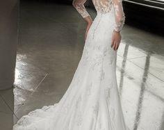 Lace wedding dress. Long sleeves wedding dress. Trumpet wedding dress.Two piece wedding dress Sexy wedding dress. V-neck lace wedding dress.