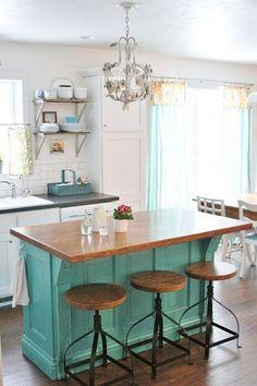 Love the pop of aqua color in a white kitchen