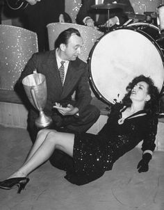 An exhausted Joan Crawford after winning a jitterbug contest with partner Allen Jenkins in 1942