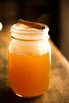 apple cider in a jar with a cinnamon stick. maybe have this at a campout/bonfire gathering.
