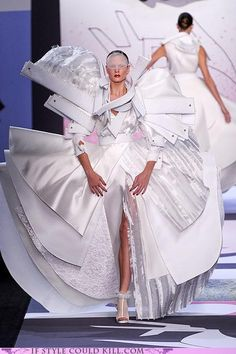 Viktor & Rolf...now talk about exagerated body parts!!  Whoa!