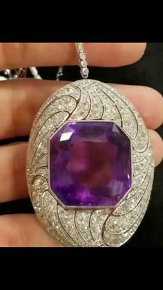 Art Deco Amethyst Pendant/Brooch. This rich purple stone is set in Platinum and surrounded by rose-cut Diamonds and old mine-cut Diamonds.