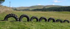different size tires. Cross Country Horse Jumping Course, Dumfries, Scotland