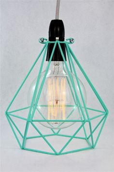 This is a diamond metal cage light pendant with a 3m cord length and wall plug.Name: 'Diamond Xanadu'.Cord: Silver, 3m.Cage: Diamond shape. Peppermint. Height: 235mms Diameter: 210 mm.Lamp holder: Black, Bayonet with on/off switch.Plug: Black, Three Pin.Additions: None. Light bulb not included.All pendants are designed and created by Empirical Style within Australia.                       Please note that they take up to 5 working days to complete before posting.All pendants can be created…