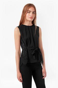 <ul> <li> Sleeveless printed top with semi-sheer lace sides and back panel</li> <li> Lace back panel with peplum hem and eyelash trim</li> <li> Self-tie waist belt- can be tied to the front or back</li> <li> Round neck</li> <li> Rouleau loop back fastening with keyhole cut-out</li> <li> UK size 10 length is 58cm</li> </ul>