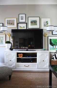 Adding swing-arm lamps to our living room TV gallery wall:  http://emilyaclark.blogspot.com/2013/03/wall-lamps-for-our-living-room.html