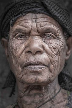 """Tattoo and Wrinkles - Portrait of an elderly woman (Lalibela, Ethiopia).  Visit http://robertopazziphotography.weebly.com/, subcribe to the newsletter and download the ebook """"Streets of the World"""" as welcome gift!  Web Site: http://robertopazziphotography.weebly.com/ Instagram: Roberto_Pazzi_Photography Facebook: Roberto Pazzi Photography"""