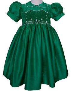 Perfect for Mardi Gras theme parties, weddings,  this deep emerald green silk smocked dress will take your breath away.   www.carouselwear.com