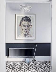 carrelage original - carreaux de ciment à motifs losanges en noir et blanc et tableau décoratif