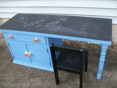 How to use an old water damaged nightstand to make a fun kid's desk with a chalkboard. Fun knobs made from abc blocks.