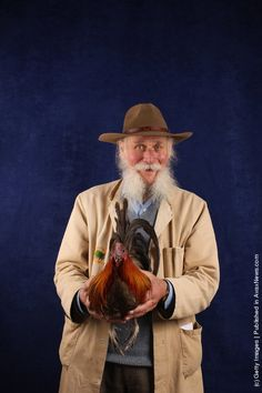 Dave Thorn, from Oxfordshire, holds his 12 month old Oxford Dun Cock