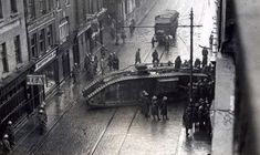"British Tank Dublin street January 1921. ""i think it my be Talbot Street. no 4 is near to Capel Street as the fruit market can be seen in the background of the photo."""