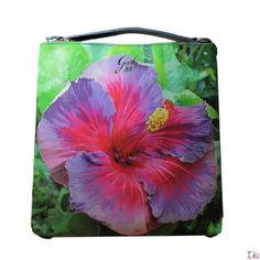 Shopper in pvc con disegno stampato di un fiore ibiscus sui toni del verde e fuxia. Collezione primavera/estate 2014
