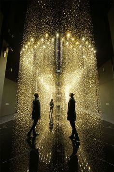Tsuyoshi Tane of DGT Architects has created an art installation titled 'Light is Time' consisting of 80,000 analog watch main plates, the primary basic component of a watch. The small disks are suspended from the ceiling in such a way that people can walk through them, like a shimmering, golden forest.