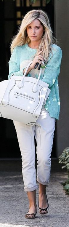 Who made  Ashley Tisdales green skull sweater, white jeans, animal print ballet flat shoes, and white handbag?
