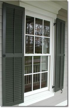 CURB APPEAL – another great example of beautiful design. Exterior window shutters are nice and provide color impact on a home faceade.