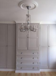 Grey fitted panelled door wardrobe
