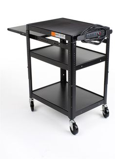 23 x 43 x 17 Inches Media Cart with Extendable Tray, Height-Adjustable Shelf, Anti-Slip Pad, 4 Wheels and 4 Outlet Surge Protector, Black Powder-Coated Steel Computer Desk Design, Formal Business Attire, Home Studio Photography, Class Decoration, Kitchen Cart, Adjustable Shelving, Power Strip, Drafting Desk, Tray
