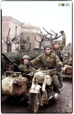 Fallschirmjäger Kradschützen of 4./FJR. Division riding on a BMW R75, move up to contain the Allied Anzio bridgehead in Italy, late January 1944. (Colourised by Doug)