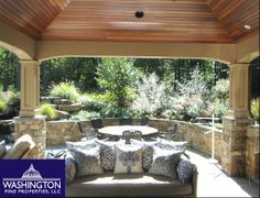 Take a break in the shade in the stunning seating area next to the beautiful pool at 10605 Willowbrook Drive in Potomac, MD!