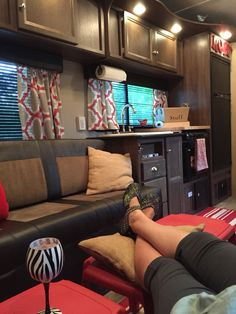 Ruby the Rubicon toy hauler. 2016 new trailer re-decorating. New curtains and little stacking tables making it cozy when the dining table is stored away!