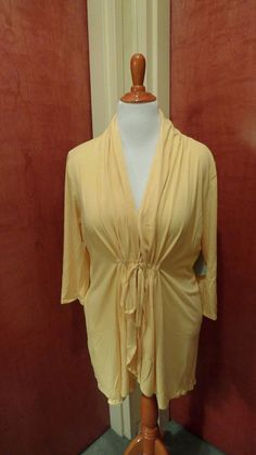 This lightweight yellow Sunset Stroll Bellini style sweater is a perfect choice to pack for a cruise!