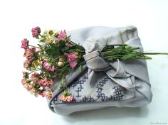 Lovely vintage embroidered napkin and Nosegay bouquet furoshiki gift wrap gives this gift a romantic feel.