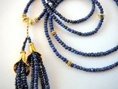The Cleo: Two lovely vermeil lily tassel caps with lapis strands are hanging from one 30 strand of midnight blue lapis that is accented with freshwater pearls and vermeil beads. Its a modern take on, or reminiscent of, a piece that Cleopatra may have worn and that is how it got its name.  This delicate piece was created to wear with the Alexandria, 15 strand bracelet, but it does quite well on its own.