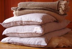 HANDMADE WOOL BED PILLOWS - Starting at  A good night's rest can do wonders, especially when it's on a comfy, hypoallergenic pillow. Dashing Star Farm, a small farm located in New York's bucolic Hudson Valley, makes all-natural wool pillows customized to any desired firmness. The soft, breathable wool roving is covered with a classic blue striped, U.S.-made cotton canvas.    + at Dashing Star Farm