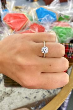 This classic four prong engagement ring features a round diamond center stone, a yellow gold setting, and graduating pave diamonds. #yellowgold #gold #setting #engagementrings #rounddiamond #diamond #pave