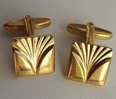 a5e19c9fd435 A pair of square vintage cufflinks made of gold coloured metal The faces  are rounded and