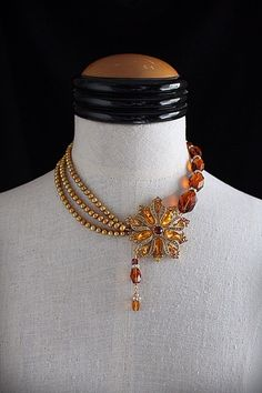GOLDEN GLOW Repurposed Vintage Jewelry Pearl Crystal Statement Necklace by carlafoxdesign on Etsy https://www.etsy.com/listing/126807377/golden-glow-repurposed-vintage-jewelry