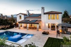 Lucury: The 4,851 sq ft home, in a gated community, features seven bathrooms, a movie room...
