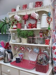 great place to have a coffee &/or hot cocoa bar in your home...simple inexpensive way to decorate & utilize the space in a small kitchen...