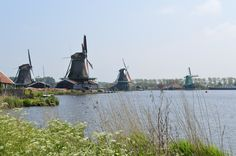 Windmills on the water at Zaanse Schans, Netherlands. Great day trip from Amsterdam with the kids.