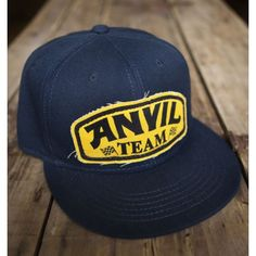 Blue hat, with yellow and black in printed canvas stitched on the front. 100% acrylic twill. by Anvil Motociclette. http://ferro29.com