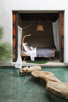 Modern bohemian- the room is a little too bohemian, but I like the idea of a shaded reading/napping nook and the stones leading to it across the pool
