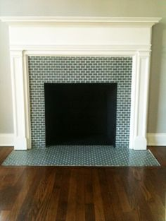 mini glass subway tile, glass tile on hearth – Fireplace tile ideas Subway Tile Fireplace, Fireplace Tile Surround, Fireplace Hearth, Fireplace Surrounds, Fireplace Design, Subway Tiles, Fireplace Glass, Brick Fireplaces, Simple Fireplace