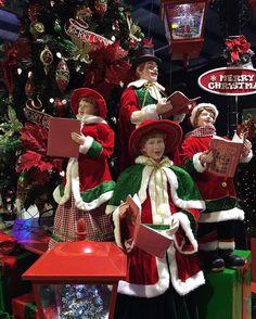 traditional christmas tree display at christmas elves christmas carollers redandgreen retail - Christmas Carollers