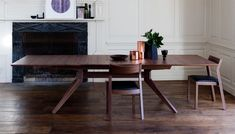 The award-winning Cross extending table exemplifies designer Matthew Hilton's ultra-modern approach to wooden furniture craft. Practical and adaptable, simple lines build to create the contemporary shaped base while extendable panels allow the table top to quickly reconfigure for extra dining space.