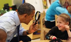 President Barack Obama gets a closer look as he plays with a child at College Heights Early Childhood Learning Center in Decatur, Georgia. Obama is proposing a nationwide initiative for children in pre-kindergarten.
