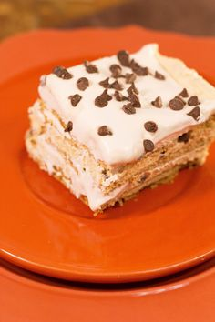 Easy Pumpkin Eclair Cake Ingredients  8 ounces cream cheese image: http://images.intellitxt.com/ast/adTypes/icon1.png , softened 1/4 cup whipping cream 1 cup powdered sugar 1 cup canned pumpkin (see note) 1/2 teaspoon pumpkin pie spice 2 (8-ounce) tubs frozen whipped topping, thawed 3 sleeves graham crackers 1 cup mini chocolate chips